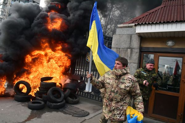 Fighters of the Aydar Ukrainian volunteer battalion, burn tyres at the entrance to the Ukrainian Defence Ministry in Kiev, on