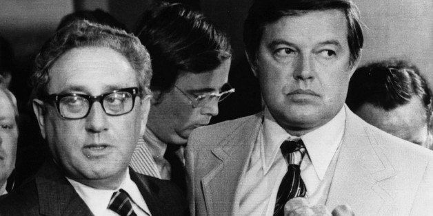 Not Involved - Secretary of State Henry Kissinger, flanked by Sen. Frank Church, D-Idaho, tells a Capitol Hill news conferenc