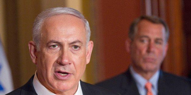 House Speaker John Boehner of Ohio looks on at right as Israeli Prime Minister Benjamin Netanyahu makes a statement on Capito