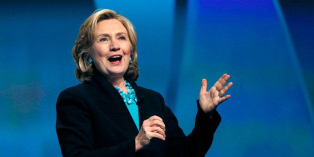 FILE - This Dec. 4, 2014, file photo shows former Secretary of State Hillary Rodham Clinton speaking at the Massachusetts Con