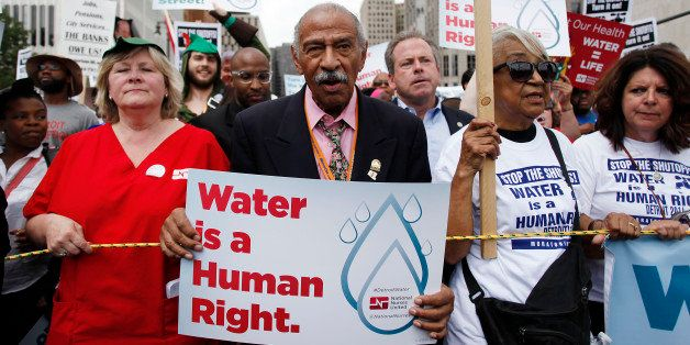 DETROIT, MI - JULY 18 : Congressman John Conyers, Jr., (D-Mich.) clinches his fist as he joins demonstrators protesting again