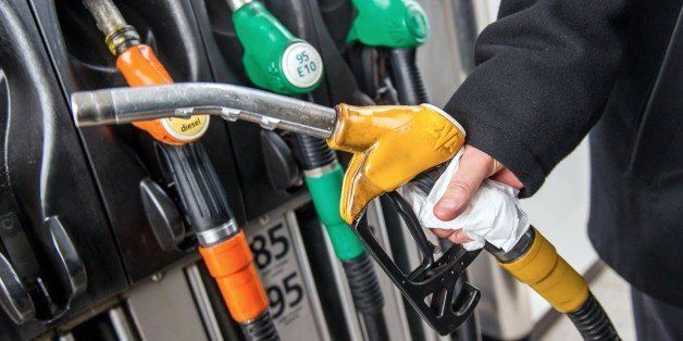 A motorist uses a pump at a petrol station on the A25 motorway near Godewaersvelde, northern France, on January 16, 2015. Oil