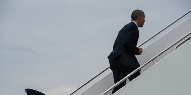 US President Barack Obama boards Air Force One at Andrews Air Force Base in Maryland as he departs for a four-day trip to Cal