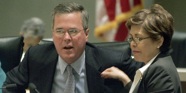 Florida Gov. Jeb Bush, left, and First Lady Columba Bush, right, participate in the annual statewide drug summit on Wednesday