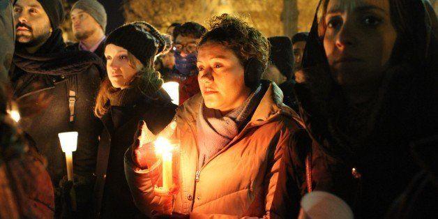 WASHINGTON, UNITED STATES - FEBRUARY 12: People hold a vigil at Dupont Circle in Washington on February 12, 2015 for three Mu