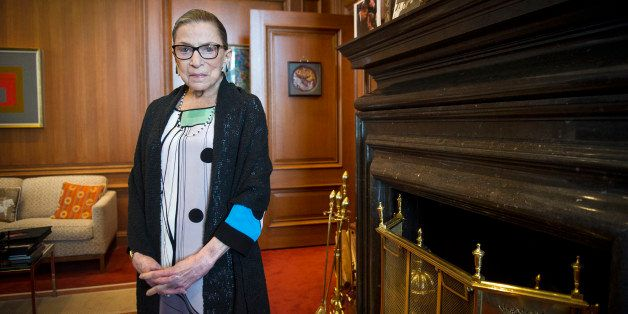 FILE - In this July 31, 2014 file photo, Supreme Court Justice Ruth Bader Ginsburg stands in her Supreme Court chambers in Wa