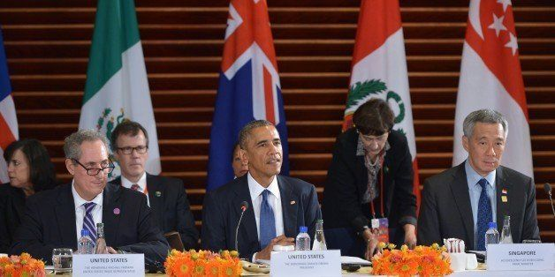 US President Barack Obama speaks (C) during a meeting with leaders from the Trans-Pacific Partnership at the US Embassy in Be