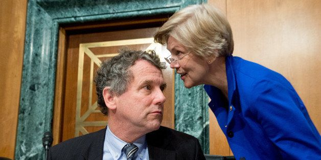 WASHINGTON, DC - JANUARY 27: Ranking Member Sen. Sherrod Brown (D-Ohio), left, speaks with Sen. Elizabeth Warren (D-Mass.), r