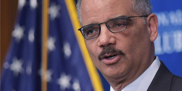 US Attorney General Eric Holder speaks on criminal justice and sentencing reform at the National Press Club on February 17, 2