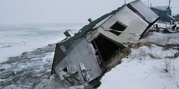 ** ADVANCE FOR TUESDAY, DEC. 26 **Nathan Weyiouanna's abandoned house at the west end of Shishmaref, Alaska, Dec. 8, 2006, si