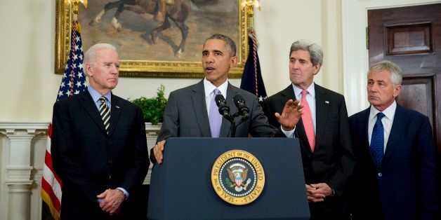 U.S. President Barack Obama, second from left, delivers a statement on legislation he sent to Congress to authorize the use o