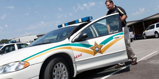 In an Aug. 3, 2011 photo, Warren County Sheriff Jackie Metheny gets in a patrol car at the Warren County Sheriff's office in