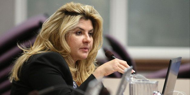 FILE - In this June 3, 2013, file photo,  Nevada Assemblywoman Michele Fiore, R-Las Vegas, works in committee during the fina