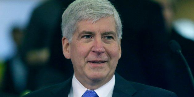Michigan Gov. Rick Snyder is seen before proposing his state budget, Wednesday, Feb. 11, 2015 in Lansing, Mich. The governor