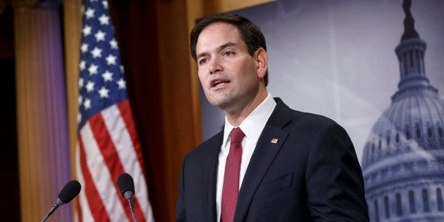 FILE - In this Dec. 17, 2014 file photo, Sen. Marco Rubio, R-Fla. speaks on Capitol Hill in Washington. Rubio seems to be mov