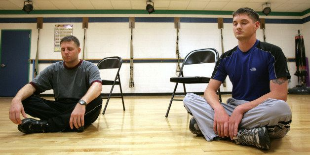 U.S. Marine Corps Corporal Pete Jarzabek, left, and Sargeant Ryan Barnett meditate during Warrior Mind Training class at Camp