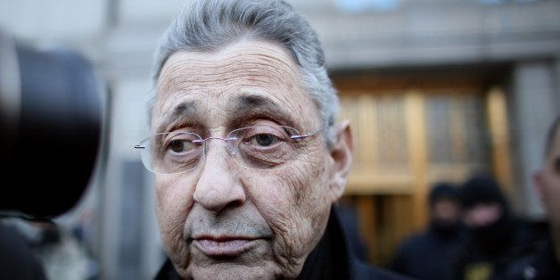 NEW YORK - JANUARY 22: New York State Assembly Speaker Sheldon Silver walks out of the Federal Courthouse after his arraignme