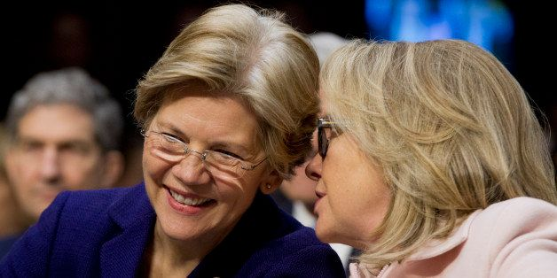 Senator Elizabeth Warren, a Democrat from Massachusetts, left, and U.S. Secretary of State Hillary Clinton talk during a Sena