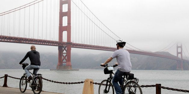 Bicyclists ride to the Golden Gate Bridge in San Francisco, Wednesday, Aug. 3, 2011. Golden Gate Bridge officials have skirte