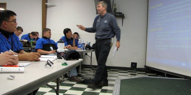 FILE - In this June 30, 2009 file photo, Larry Wostenberg teaches an engine management systems class at the WyoTech technical