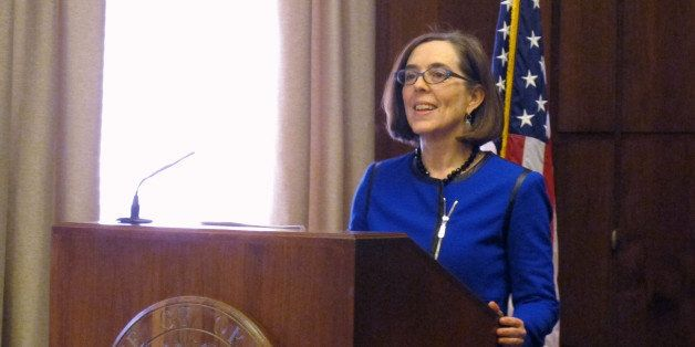 Oregon Gov. Kate Brown speaks to reporters at the state Capitol in Salem, Oregon on Friday, Feb. 20, 2015. In her first press