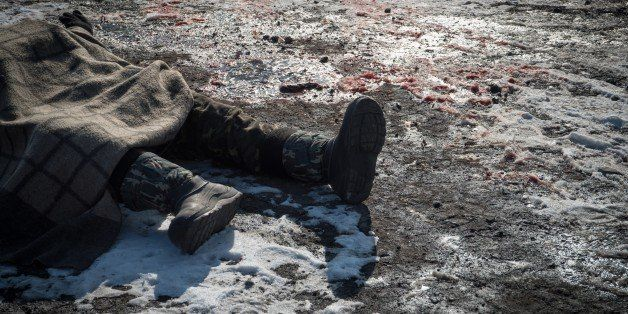 A picture shows a body of a Ukrainian serviceman in the eastern Ukrainian city of Debaltseve on February 20, 2015. Germany an