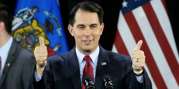 FILE - In a Tuesday, Nov. 4, 2014 file photo, Wisconsin Republican Gov. Scott Walker gives a thumbs up as he speaks at his ca