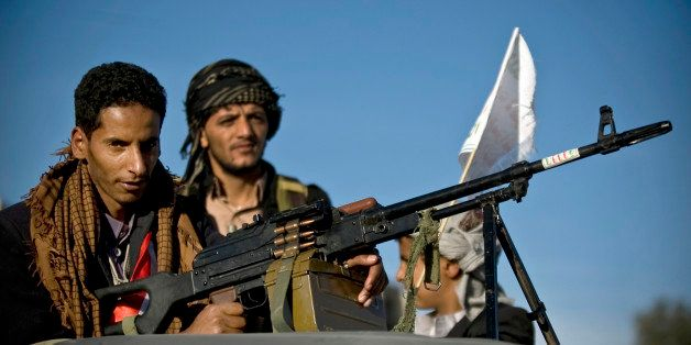 FILE - In this Saturday, Oct. 4, 2014 file photo, A Houthi Shiite rebel holds a weapon while on patrol following dawn prayers