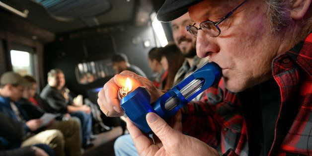DENVER, CO. - DECEMBER 06: Zane Swiley of Savannah, GA smokes pot on the bus during a marijuana tour hosted by My 420 Tours i