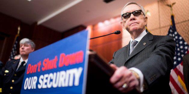 UNITED STATES - FEBRUARY 24: Senate Minority Leader Harry Reid, D-Nev., speaks during the Senate Democratic Caucus' news conf