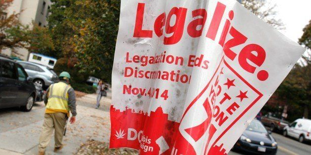 A 'legalize' poster for a referendum about legalizing marijuana is placed in Washington, DC on October 31, 2014.  Ballot Init