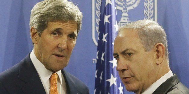 US Secretary of State John Kerry (L) shakes hands with Israeli Prime Minister Benjamin Netanyahu in Tel Aviv on July 23, 2014