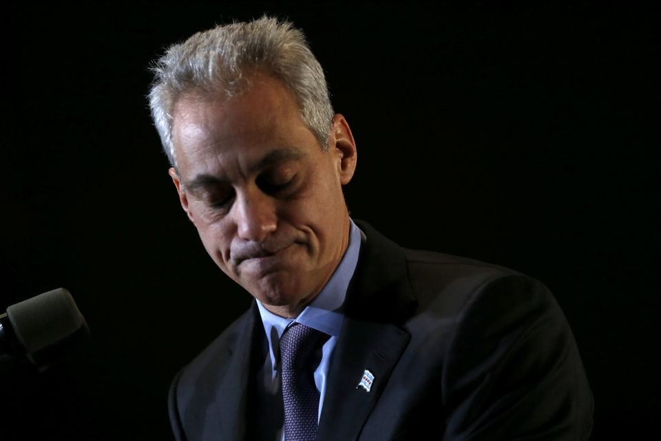 Chicago Mayor Rahm Emanuel pauses as he talks to supporters after he was unable to get a majority vote in the Chicago mayoral