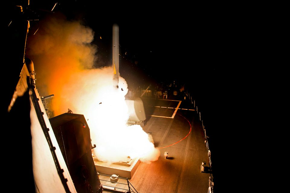 The guided-missile destroyer USS Arleigh Burke launches a Tomahawk cruise missile in the Red Sea, Sept. 23, 2014, to conduct