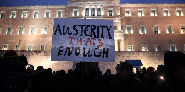 Pro-government protesters gather in front of Greece's parliament to back its demands of a bailout debt renegotiation in centr