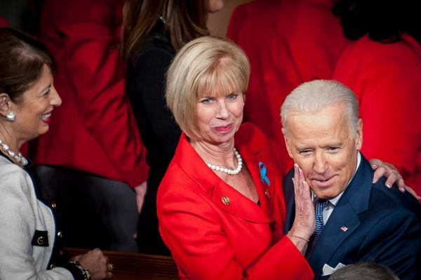 Rep. Janice Hahn, a Democrat from California, wipes her lipstick from the cheek of U.S. Vice President Joseph 'Joe' Biden as