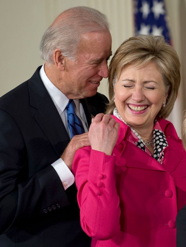 Vice President Joe Biden, left, and Secretary of State Hillary Clinton share a laugh during a signing ceremony for the Lilly