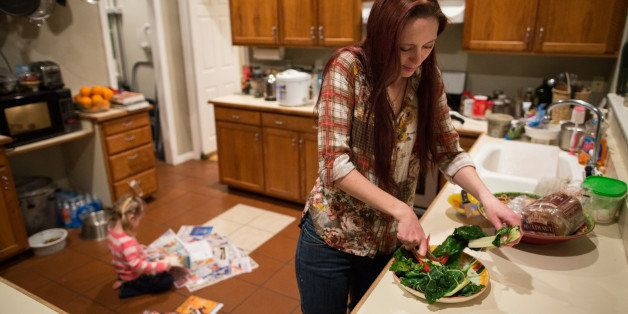 Maggie Barcellano prepares dinner at her father's house in Austin, Texas on Saturday, Jan. 25, 2014. Barcellano, who lives wi