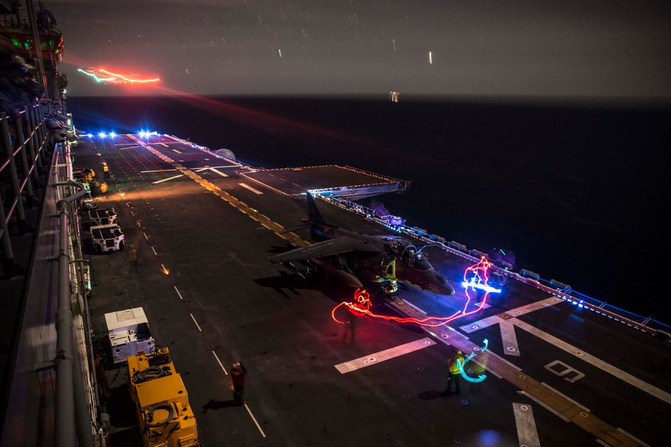 An AV-8B Harrier with Marine Medium Tiltrotor Squadron 161 (Reinforced), 15th Marine Expeditionary Unit, prepares to take-off