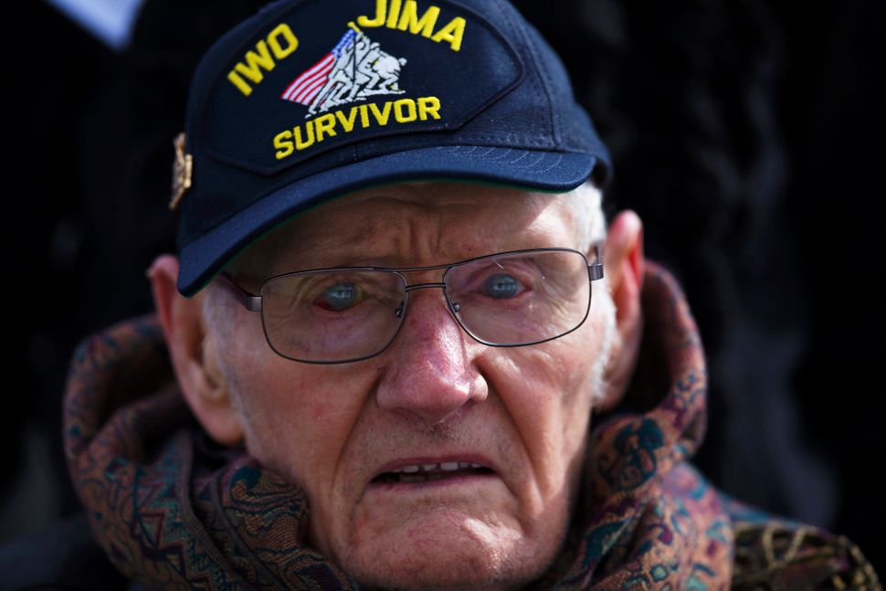 Lloyd Ford, a Marine veteran of World War II, observes a wreath laying ceremony at the Marine Corps War Memorial in Washingto