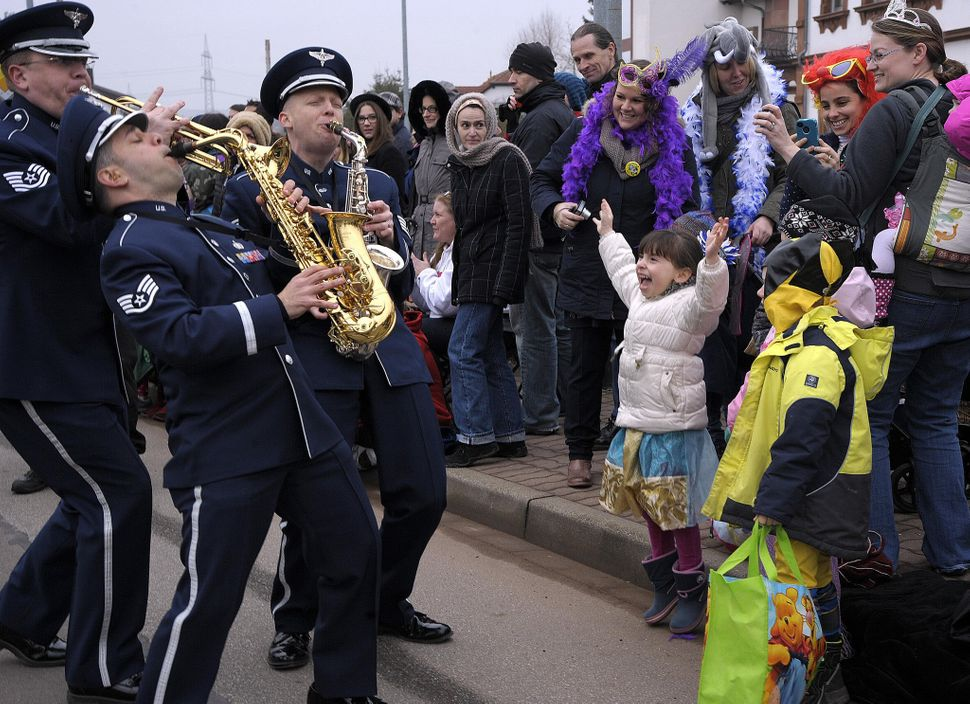 Members of the U.S. Air Forces in Europe Band interact with the crowd during the Fasching parade Feb. 17, 2015, in Ramstein-M