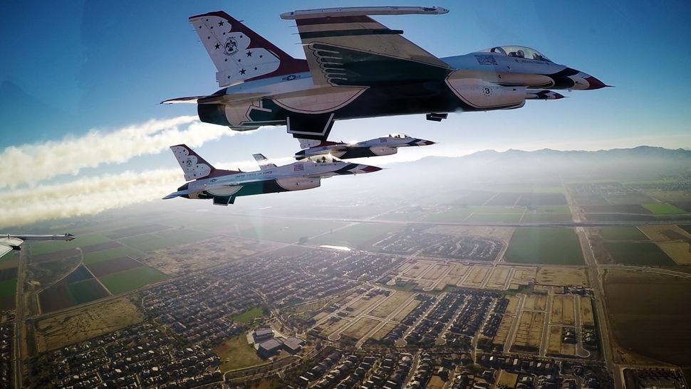 Thunderbirds pilots approach the University of Phoenix Stadium to perform a flyover during the Super Bowl XLIX game, Phoenix,