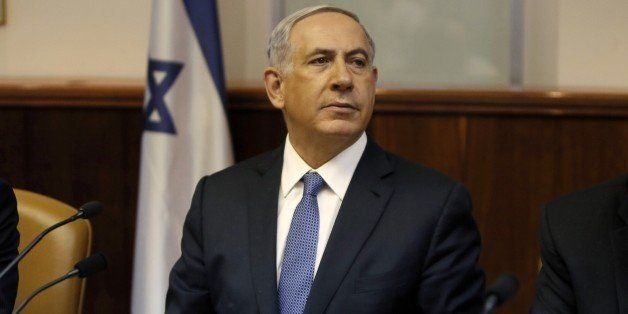 Israeli Prime Minister Benjamin Netanyahu looks on as he opens the weekly cabinet meeting at his Jerusalem office on February