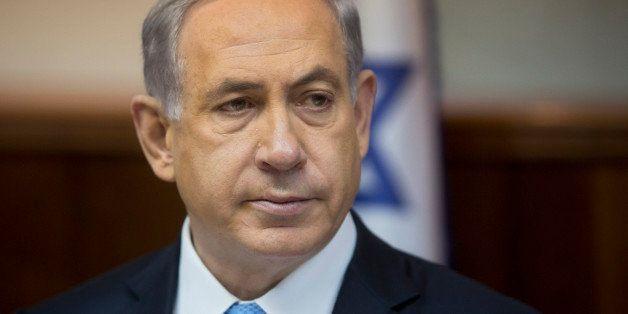 Israeli Prime Minister Benjamin Netanyahu attends the weekly cabinet meeting in his Jerusalem office, Sunday, Feb. 8, 2015. (
