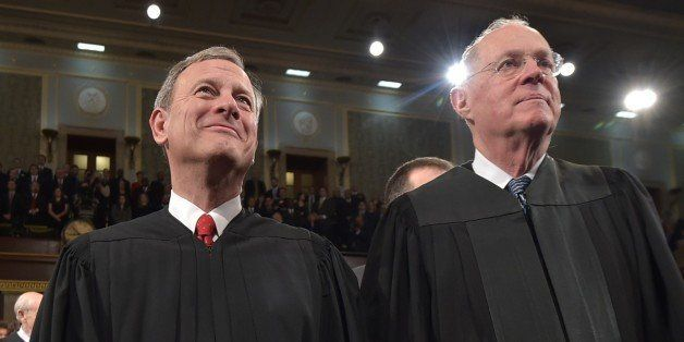 WASHINGTON, DC - JANUARY 20:  U.S. Supreme Court Chief Justice John G. Roberts (L) and Justice Anthony M. Kennedy stand befor