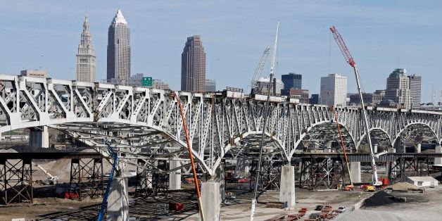 Crews dismantle the old Innerbelt bridge in Cleveland Wednesday, April 16, 2014. Demolition of the old bridge will make way f