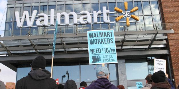 WASHINGTON, DC - NOVEMBER 28:  Protesters gather in front of a Walmart store in the nations capital Friday to demand better w