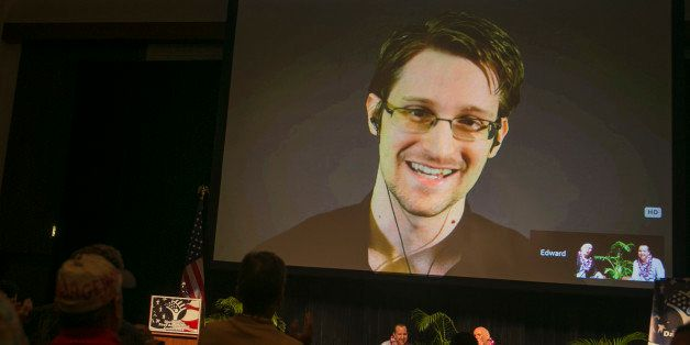National Security Agency leaker Edward Snowden appears on a live video feed broadcast from Moscow at an event sponsored by th