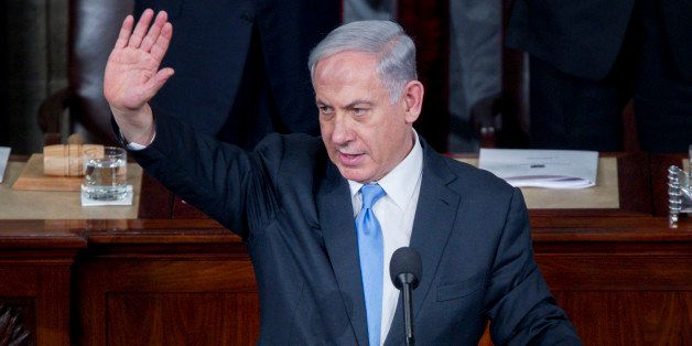 Benjamin Netanyahu, Israel's prime minister, waves after speaking during a joint meeting of Congress in the House Chamber at