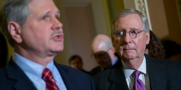 Senate Majority Leader Mitch McConnell, a Republican from Kentucky, right, looks on as John Hoeven, a Republican from North D